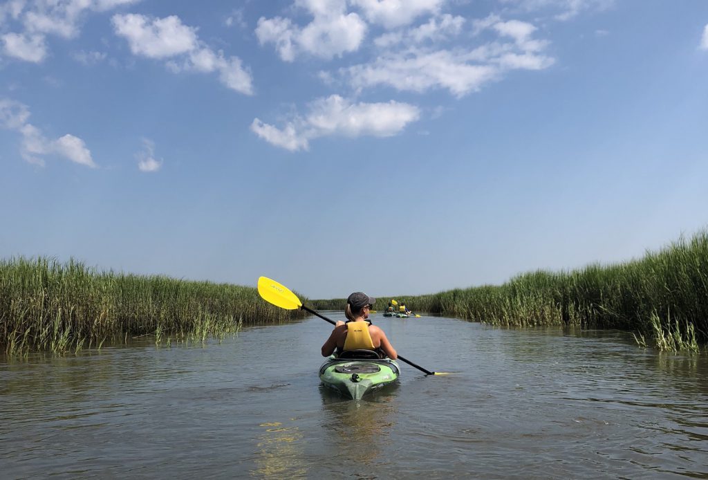 Girl kayaking in marshes around Hilton Head SC